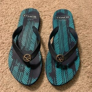 Coach navy and teal flip flops.
